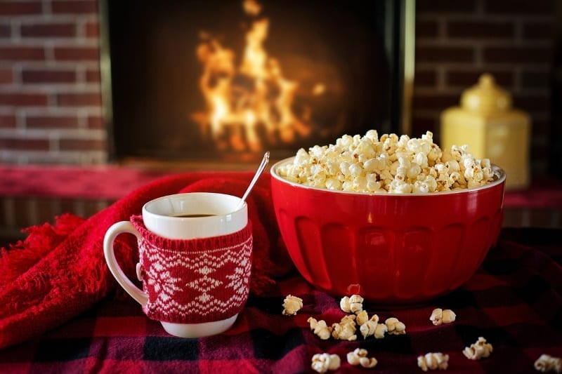self-care during the holidays with comfort food in front of a fire