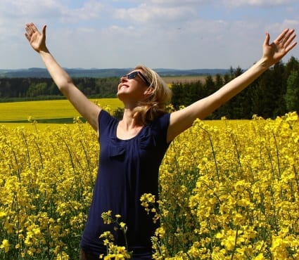 woman in field - self-improvement tips for personal development